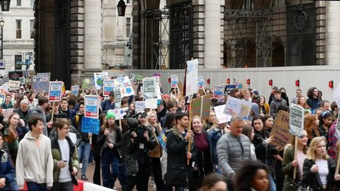 London, UK - March 15 2019: The School strike for climate, the studentes protest in the street in London