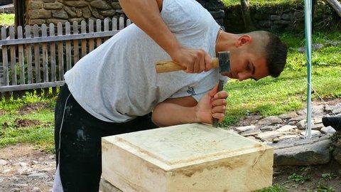 Etar, Bulgaria - 09 02 2017: Etar Bulgaria Ethnographic Set. September 2, 2017. International Fair of Crafts. Students stonemasons make copies of stone sculpture.
