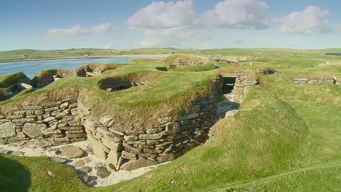 Pan across the Stone neolithic house remains of the prehistoric village of Skara Brae archaeological site, Bay of Skaill , Mainland, Orkney Island, Scotland,