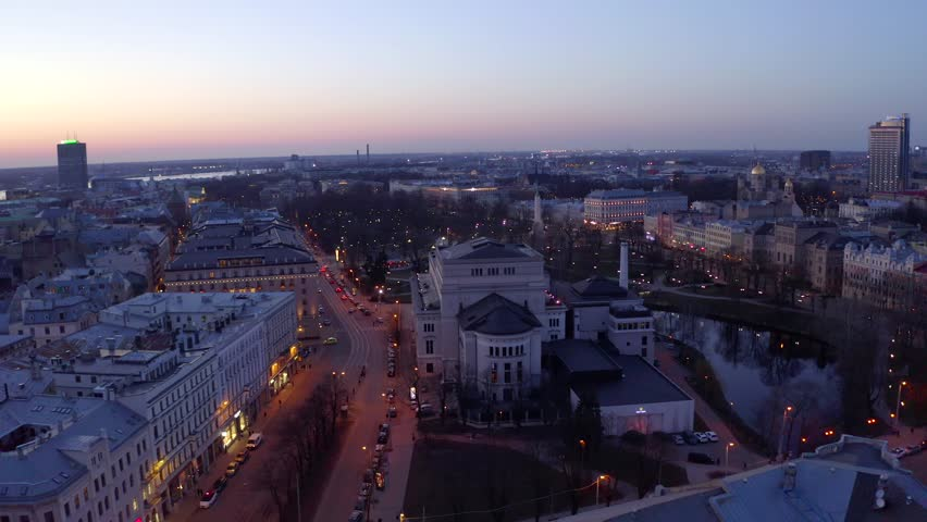 Flying over beautiful Riga at twilight and night. Riga Opera House, statue of liberty and the old town. | Shutterstock HD Video #1026986405