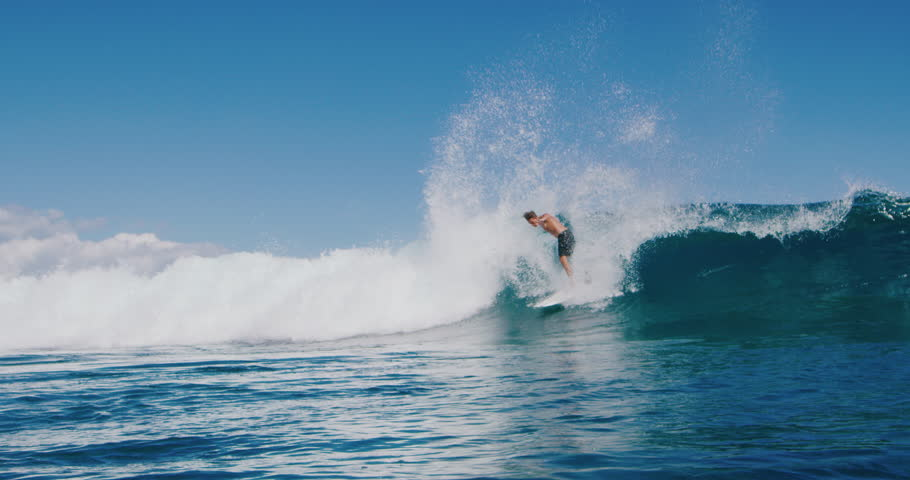 Surfer carving huge backside turn with spray on blue ocean wave, surfing ocean lifestyle, extreme sports, slow motion | Shutterstock HD Video #1027016195