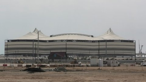 Al Khor, Qatar - February 23, 2019: closeup of At Bayt Stadium with work in progress, in Al Khor City, one of 12 venues used in 2022 FIFA World Cup. Copy space with blue sky.