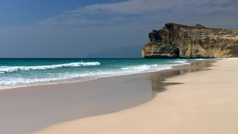 Sea waves striking sand beach near Salalah, Oman (Arabian Peninsula)