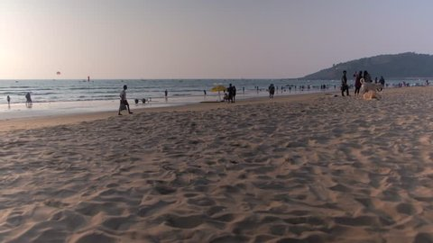 Tourists, international and locals, at the busy and crowded beaches of Calangute & Baga, popular vacation and holiday destination in Goa, a western state in  India
