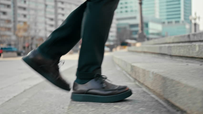 Close Up 4K Slow Motion Shot of Office Worker Man Walking Upstairs Outdoors in City. Male Feet in Suit and Platform Shoes Making Steps to Climb Up the Stairs | Shutterstock HD Video #1027225115