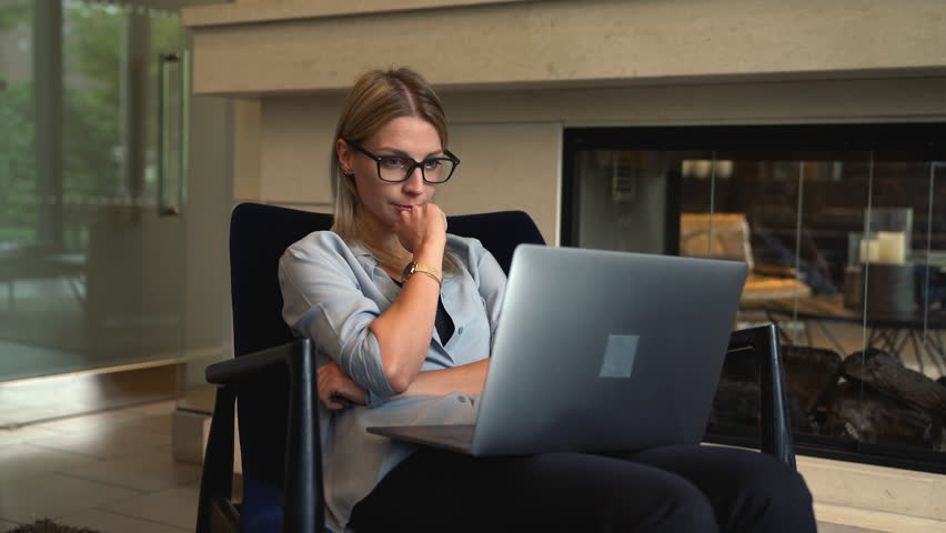Young female copywriter creating text for posting articles on content website using netbook while working remotely indoors, woman typing email during working online on freelance via laptop computer | Shutterstock HD Video #1027256195