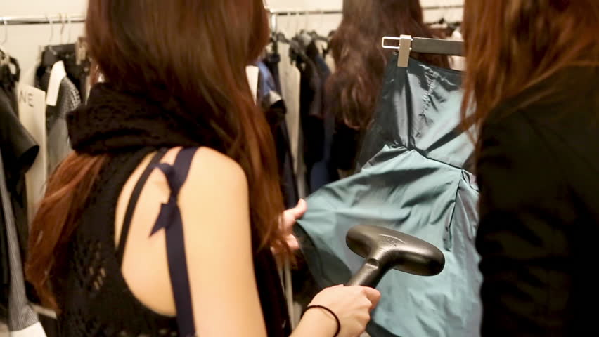 Girls steam dresses backstage before a fahsion show. | Shutterstock HD Video #1027273385