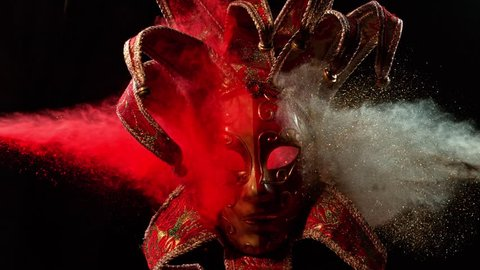 Super Slowmotion Shot of Color Powder Explosion and Venice Mask