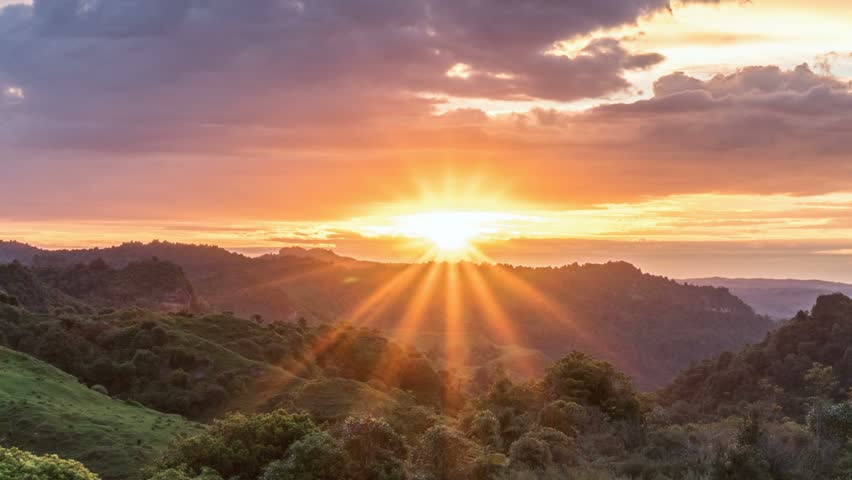 Beautiful sunrise over wild forest mountains in summer morning in New Zealand nature Time lapse #1027288325