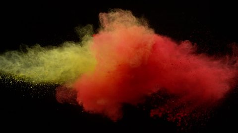 Super slow motion of coloured powder collision isolated on black background. Filmed on high speed cinema camera, 1000fps.