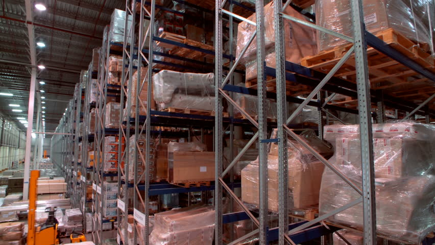 A variety of goods and cargo on the shelves in a large warehouse | Shutterstock HD Video #1027489565