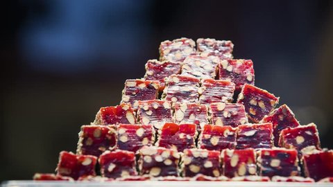 Footage of Turkish delight for dessert. Lokum dish on sale in Istanbul food store.Traditional sweet locum with sugar for snack