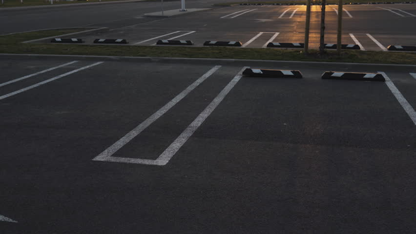 Empty parking lots shot in 80 slow motion during Golden Hour sunset at a Shopping Mall | Shutterstock HD Video #1027525055