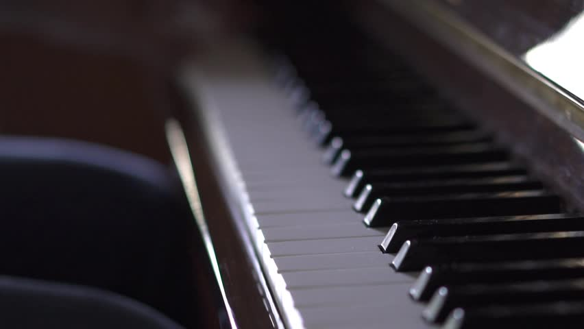 Musician plays piano, in Slow Motion video, in a room with natural light | Shutterstock HD Video #1027528835