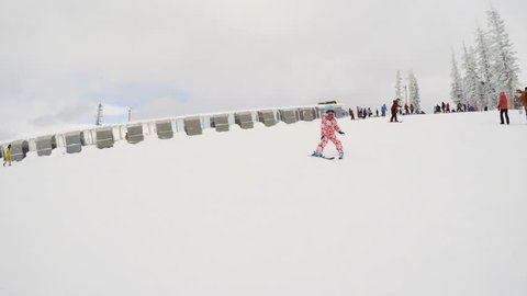 Denver, Colorado, USA-December 1, 2018 - Little girl learning how to ski in alpine mountains.
