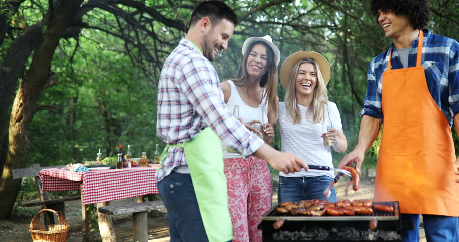 Happy friends having a barbecue party in nature   Shutterstock HD Video #1027720355
