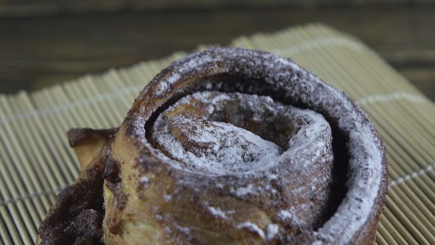 Sweet bun on rotating background  | Shutterstock HD Video #1027867295