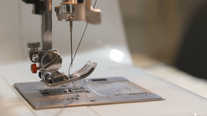 Tailor sews lingerie on a sewing machine | Shutterstock HD Video #1027884035