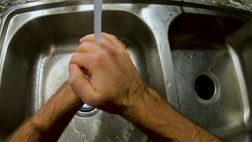 First person view of man washing his hands and drying them with a towel   Shutterstock HD Video #1027930805