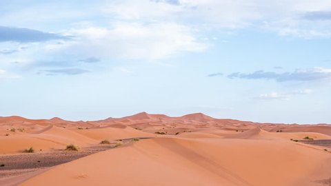 Day to night Timelapse of the dunes and the sky in the desert