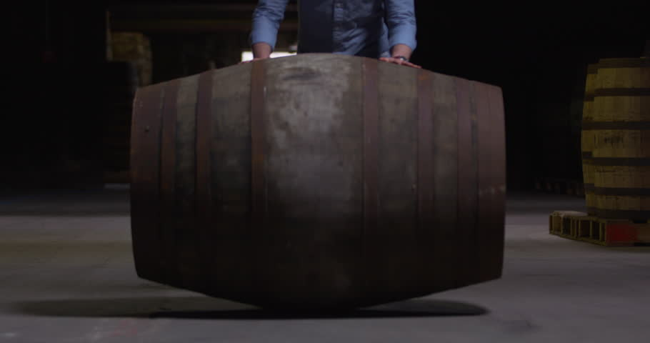 Large whiskey sherry barrel keg rolling toward camera slow motion  | Shutterstock HD Video #1028034425