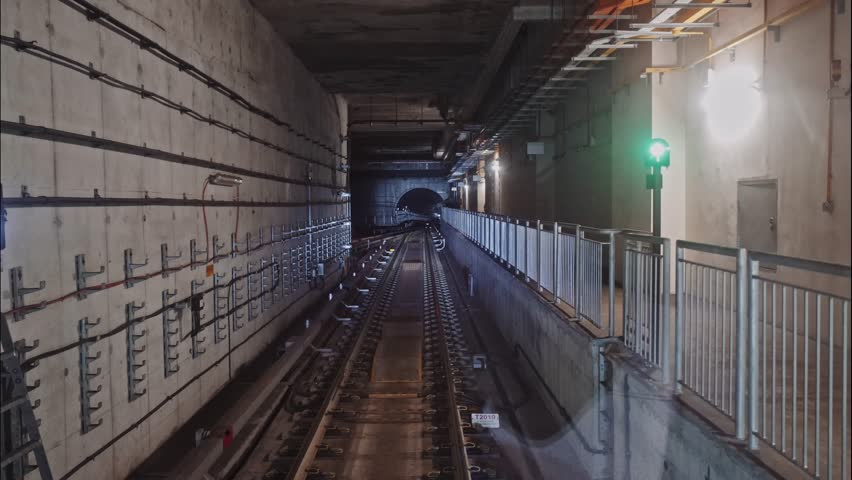 Timelapse of subway train on the route. Timelapse shot of a subway train moving in the dark tunnel and making stops at the stations, view from the cabin. | Shutterstock HD Video #1028051555