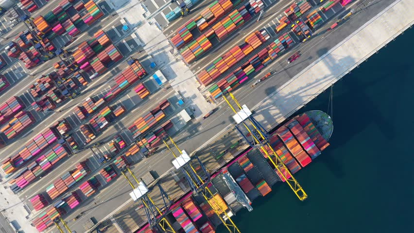 Aerial view. Container ship in pier with crane bridge carries out export and import business in the open sea. Logistics and transportation | Shutterstock HD Video #1028088965