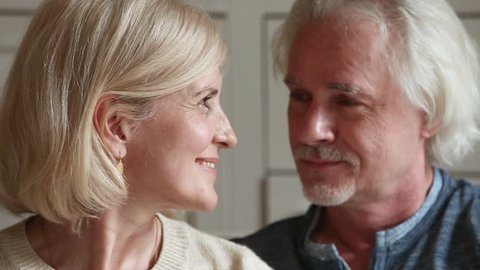 Close up portrait attractive faces elderly couple in love retired family smiles looks at camera, fifty year old spouses lifelong relationships devotion anniversary, medicare medicine insurance concept