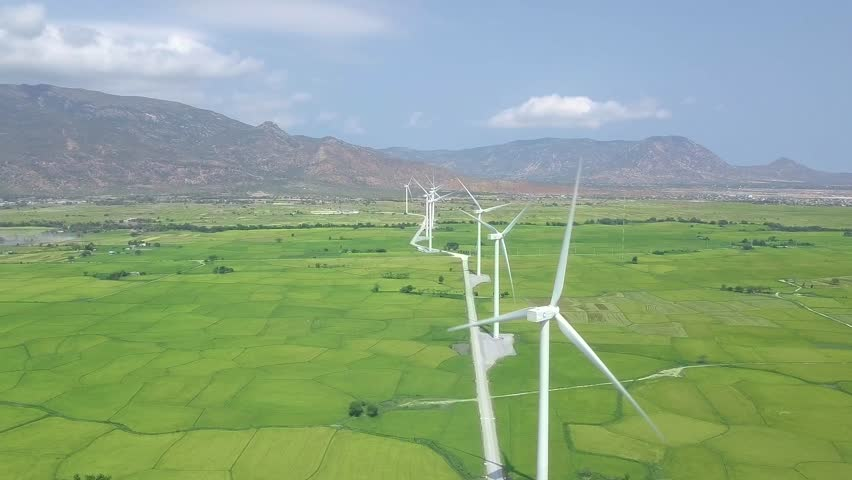 Windmill turbine on wind energy station drone view. Alternative natural source, ecology conservation. Wind turbine on green field aerial landscape. Clean and renewable energy solution #1028139335