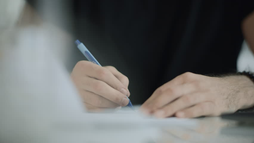 Student hand writing pen at notebook. Macro of business man hand writing pen in diary. Close up of journalist write note report. Closeup of writer hand write notepad | Shutterstock HD Video #1028144075