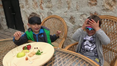 Fethiye, Turkey - 7th of April 2019: Guess what food challenge - 4K 4K Two friends play blindfold in guess what food, cryctal child