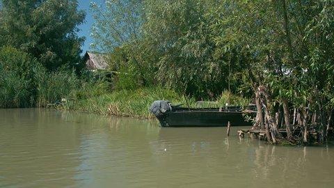 Wooden boat moored in the reed beds, Vilkovo, Ukraine