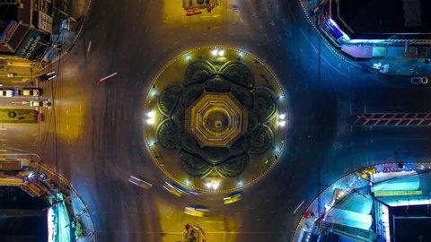 Timelape or Hyperlape Traffic on a circular road aerial shot at Chedi Sam Pluem Phra Nakhon Si Ayutthaya Province, Thailand