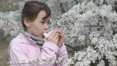 Asthma attack on pollen. Child in spring with asthma.