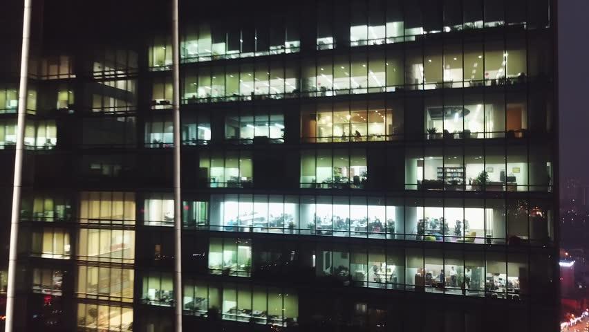 Night cinematic backwards aerial flight from skyscraper window offices people work. Metropolis active modern cityscape illumination Road traffic cars. Meeting business finance. Vietnam lotte    Shutterstock HD Video #1028346425