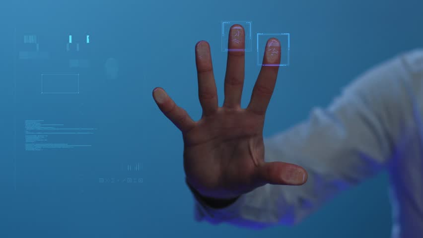 The person clicks on the fingerprint scanner, which is executed in the style of the digital future. The digital world and technology. For digital applications and solutions. Slowmotion. Shot on Arri | Shutterstock HD Video #1028530175