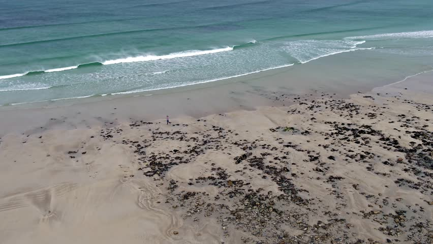 Aerial view of the famous Magheraroarty beach - Machaire Rabhartaigh - on the Wild Atlantic Way in County Donegal - Ireland.   Shutterstock HD Video #1028556515
