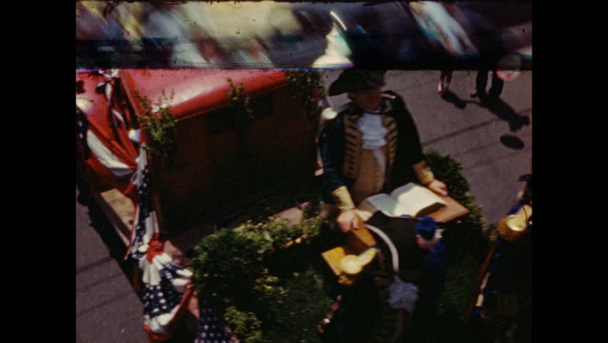 1940s: Floats pass along street in 4th of July parade. | Shutterstock HD Video #1028579825