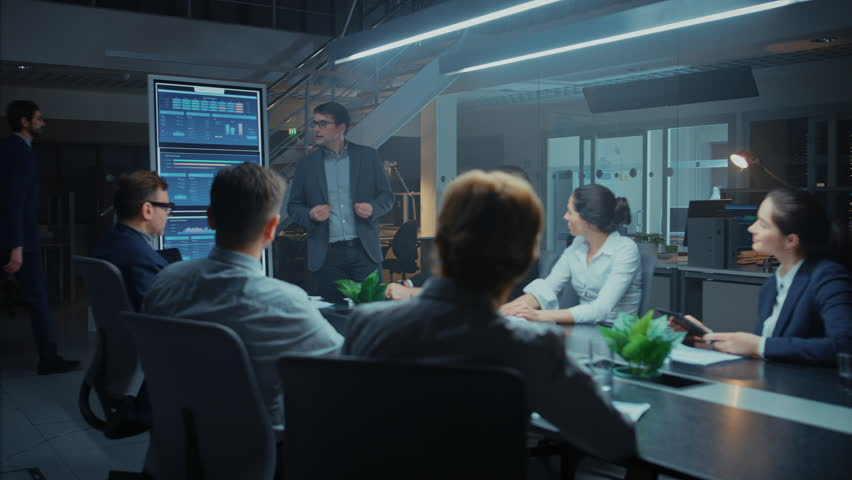 In the Corporate Meeting Room: Energetic and Confident Young Startup Creator Uses Digital Interactive Whiteboard for Presentation and Delivers Powerful Speech to a Board of Executives Investors | Shutterstock HD Video #1028612465