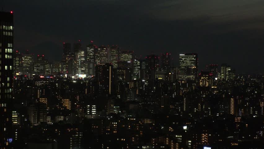 TOKYO,  JAPAN - CIRCA APRIL 2019 : Aerial view of office buildings around Shinjuku area at night.  View from Bunkyo ward. | Shutterstock HD Video #1028723915
