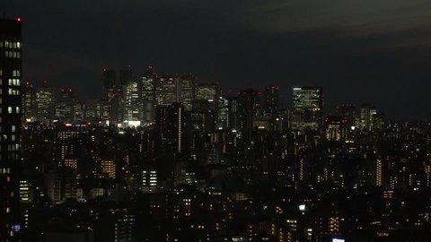 TOKYO,  JAPAN - CIRCA APRIL 2019 : Aerial view of office buildings around Shinjuku area at night.  View from Bunkyo ward.
