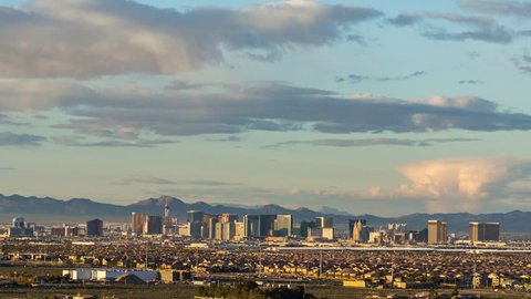 Las Vegas, Nevada / USA - 4/12/2019 : Sunset over Las Vegas as the clouds change colors and the lights of the casinos on the Strip light up for the night.