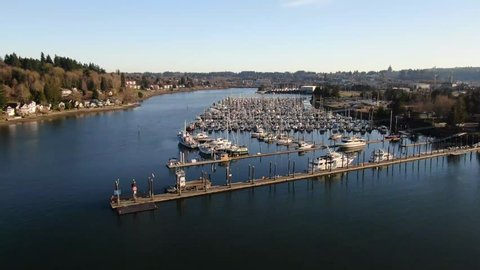 Flying over a marina at sunset in Olympia Washington on the Puget Sound