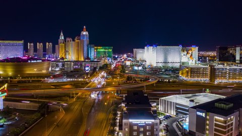 Las Vegas, Nevada / USA - April 9th 2019: Aerial view of hotels and casinos on the Las Vegas strip from above at night with freeway traffic.