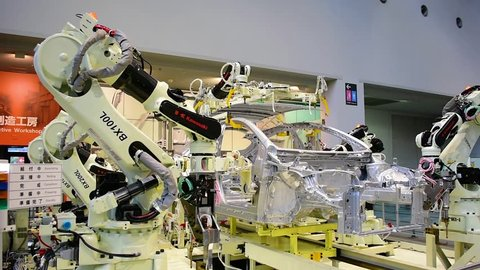 Nagoya / Japan - February 10th 2018: Robots assembling a car at Toyota Commemorative Museum of Industry and Technology