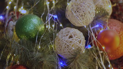 Decorated christmas tree ball. Christmas ball close up. Selective focus. Merry Christmas and Happy New Year concept. Decoration background. Defocus blurred Christmas tree with ornaments background