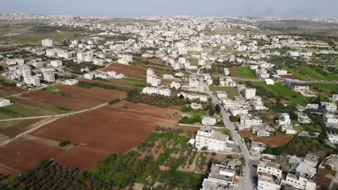 Flying over Palestinian Town Aerial view of Palestinian Town Bir nabala and el geeb