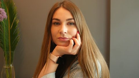 KHERSON, UKRAINE - MAY 03, 2019: Young Cute Woman Portrait with iWatch on a Wrist