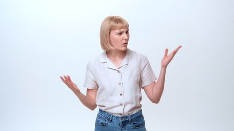 A young businesswoman with blue eyes and blonde hair is showing the emotion of being irritated and not satisfied. She is refusing an offer of selected MLM products.
