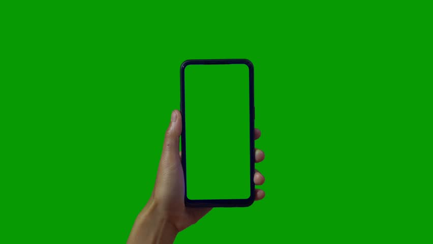Phone in the hand close up isolated at green background. Phone screen is blue chroma key, background chroma key green screen. Footage for mobile ads, app promo. | Shutterstock HD Video #1028986925